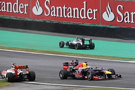 Vettel, tricampeão numa corrida maluca.
